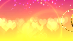 Pink yellow wedding background with two wedding rings and hearts Stock Footage