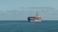 Container Ship Arriving From Sea - stock footage