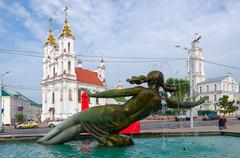 Fountain Merger of three rivers, town hall and church, Vitebsk Stock Photos