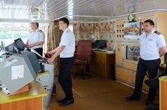 Captain of ship Alexander Benois and mates in captain's cabin Stock Photos
