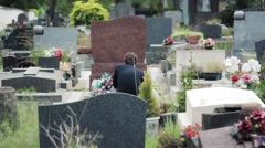 Man Prays On Tombstone In Cemetery Stock Footage