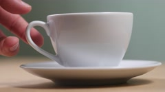 4K Tea Cup Taking and Puting Back On Saucer Stock Footage