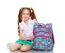Girl with the school portfolio Kuvituskuvat