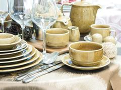 Set of dishes on table Stock Photos