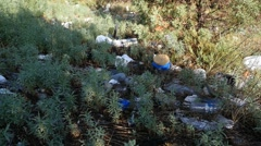 Litter and trash along a roadside Stock Footage