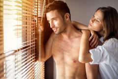 Couple in morning after sex Stock Photos