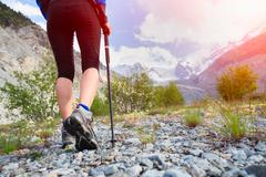 Nordic walking in the high mountains Stock Photos