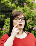 Pretty modern mature fat woman outside wearing glasses, emotional posing happy Stock Photos
