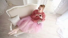 Ballerina drinking black tea and relaxing Stock Footage