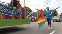 Youn male walking big rainbow flag Stock Footage