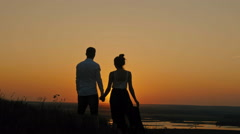 loving couple - brave young man and beautiful girl stands on high hill and - stock footage