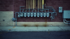 An array of meters mounted on a building wall Stock Footage