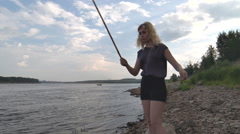 Girl Catches Fish with Bait Stock Footage