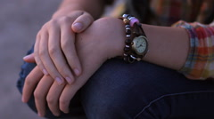 Close-up hands teenager girl checking time on watch waiting for someone who late Stock Footage
