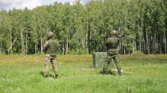 Soldier in camouflage uniforms fires anti-tank grenade launcher Stock Footage