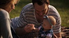 Happy family of three, with a baby, blue-eyed girl Stock Footage