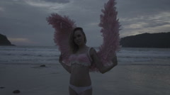Beautiful angel woman with pink wings Stock Footage