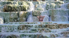 Girl Relaxing in Thermal Hot Water in Saturnia Tuscany Italy Stock Footage