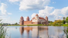 Cloud flyung over Mir castle Stock Footage