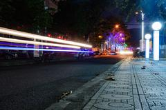 Night traffic in the city, car lights in motion blur with zoom effect Stock Photos