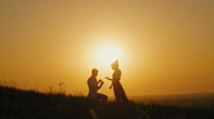 Romantic Silhouette of Man Getting Down on his Knee and Proposing to Woman on Stock Footage