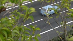 Cars passing on the highway hidden by trees Stock Footage