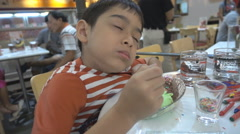 Little boy eating ice cream  slow motion Stock Footage