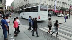 Pedestrians In Urban Center Walk Across Crosswalk Stock Footage