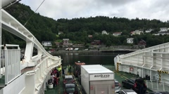 POV of Trucks Parked in Moving Ferry as it Approaches Dock Stock Footage