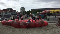 Children Playing and Bouncing on Inflated Balls at Park Stock Footage