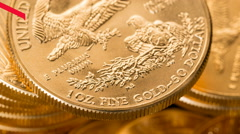 4K US Mint pure gold coins with red line graph showing falling price Stock Footage