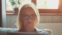 Beautiful Young Woman in glasses using tablet pc for surfing internet 2 Stock Footage