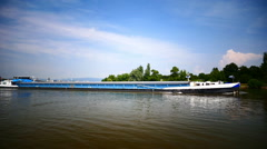 Barge boat transport ship turning from river Rhine to River Main at junction Stock Footage