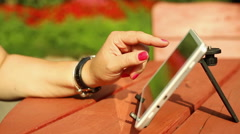 Woman fingers are touching the tablet Stock Footage