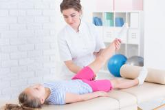 Physical therapy with child Stock Photos