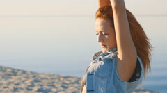 Portrait of a pretty red-haired woman at sea background Stock Footage