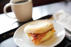 Bacon and fried egg roll with coffee Stock Photos