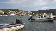 4K Beautiful Kassiopi old port in Corfu Island tourism attraction fishing boat  Stock Footage