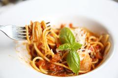 Spaghetti bolognese with shrimp Stock Photos