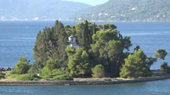 4K Aerial view of Pontikonisi Island in Corfu Greek destination iconic place day Stock Footage