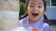 Slow motion of little girl acting very surprised Stock Footage