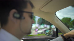 Chauffeur of elite taxi driving automobile in the city, responsible job, duties Stock Footage