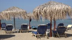 4K Beautiful Sidari beach with empty sunbed straws umbrella in Corfu Island day Stock Footage