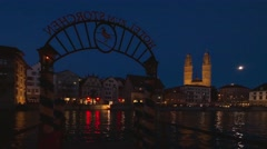 Limmatquai and Grossmunster in Zurich at Night, Switzerland Stock Footage