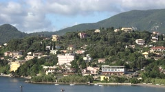 4K Aerial view of Corfu town amazing cityscape and mountain hill residential day Stock Footage