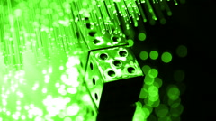 Dice with Fiber optics background, shot in HD Stock Footage