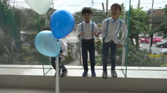 Little boys friendship jumping together with happy face slow motion HD Stock Footage