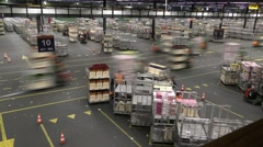 People handle flower carts at Aalsmeer FloraHolland Flower Auction Market Stock Footage