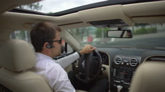 Confident businessman sitting in car, giving thumbs up gesture, business driver Stock Footage