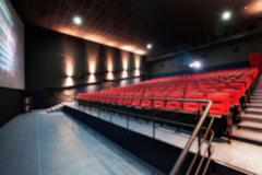Abstract blur Empty rows of red theater or movie seats. Chairs in cinema hall Kuvituskuvat